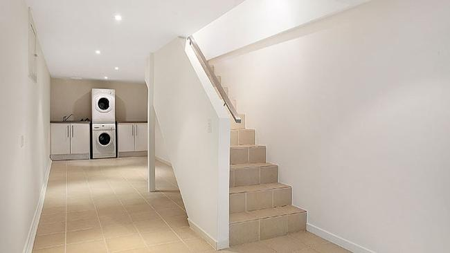 four levels including a large storage room or cellar in the basement