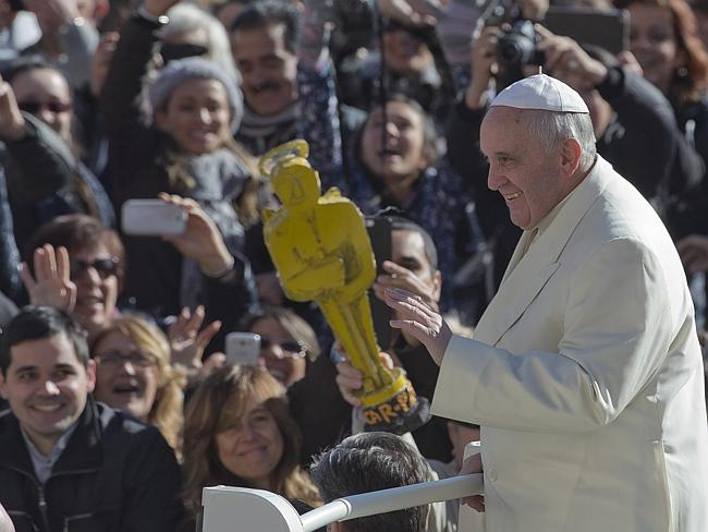 Superstar...Francis was givng a replia of an Academy Award by a crowd member during his weekly general audience this week. Picture: AP