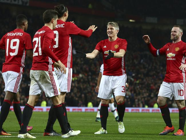Manchester United's Zlatan Ibrahimovic, third left is congratulated by teammates.