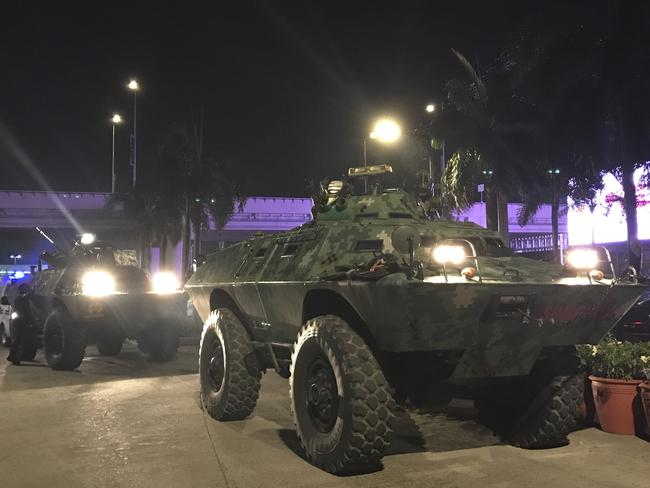 Military vehicles are positioned outside the Resorts World Manila complex. Picture: AP