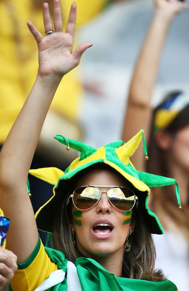A Brazilian fan enjoys the World Cup's atmosphere.