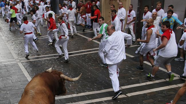 A bull runs after revellers during the running of the bulls at the San Fermin festival. Picture: AP