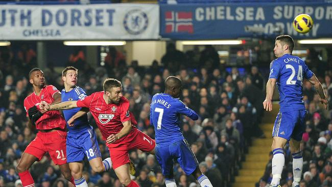 Southampton's English striker Rickie Lambert (3rd L) scores against Chelsea.