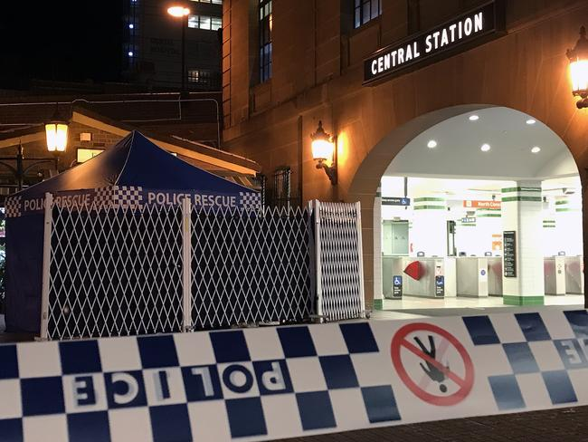 "Witnesses described the man saying ""shoot me"" and running at police. The area is now cordoned off. Picture: AAP Image/Aaron Bunch"