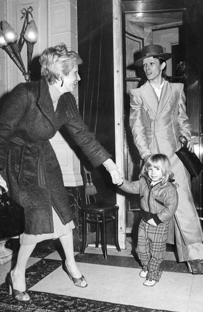 "This file photo taken on February 17, 1974 shows British rock star David Bowie, with his wife Angela (Angie) and his son Zowie, after receiving an award for his latest record ""Ziggy stardust"" in Amsterdam. Picture: AFP"