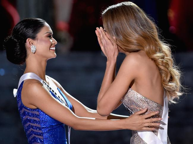 Gracious ... Miss Philippines Pia Alonzo Wurtzbach congratulates Miss Colombia Ariadna Gutierrez after she is mistakenly named the winner.