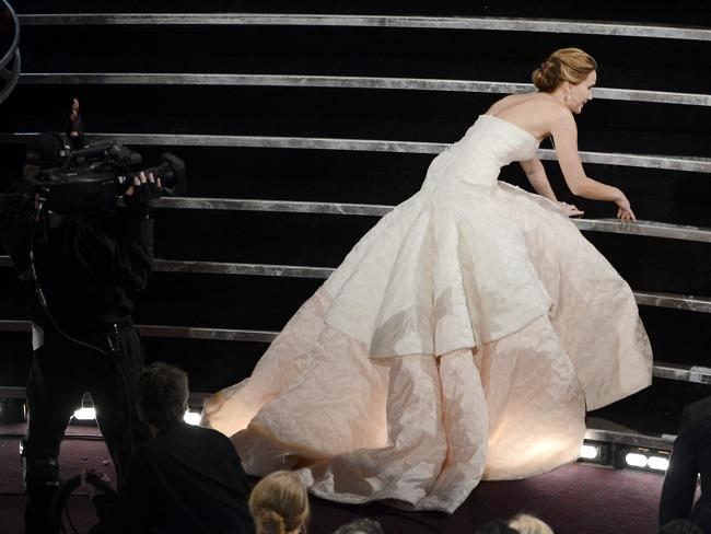 Jennifer Lawrence trips over the stairs at the Academy Awards in February. Picture: Getty