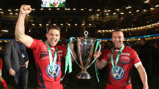 Drew Mitchell and Matt Giteau of Toulon celebrate after their victory in Cardiff.