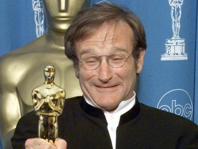 Robin Williams with his Oscar for Best Supporting Actor in Good Will Hunting.