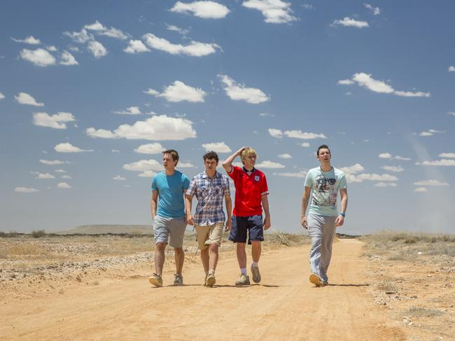 "Road kill ... The Inbetweeners (from left) Joe Thomas (as Simon), Simon Bird (as Will), James Buckley (as Jay) and Blake Harrison (as Neil) were ""stranded"" in the Outback around Marree, South Australia, during filming."