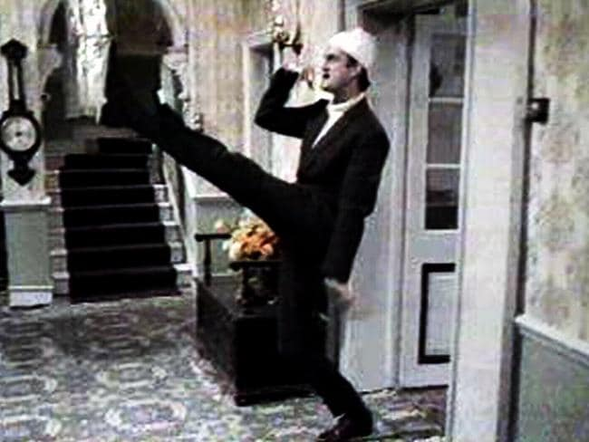 Funny man ... John Cleese as Basil Fawlty character doing impression of Adolf Hitler in TV program Fawlty Towers. Picture: Supplied