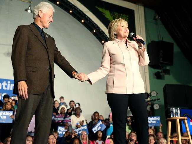 Democratic presidential candidate Hillary Clinton, accompanied by her husband former President Bill Clinton, at a rally in Iowa. Picture: AP/Andrew Harnik