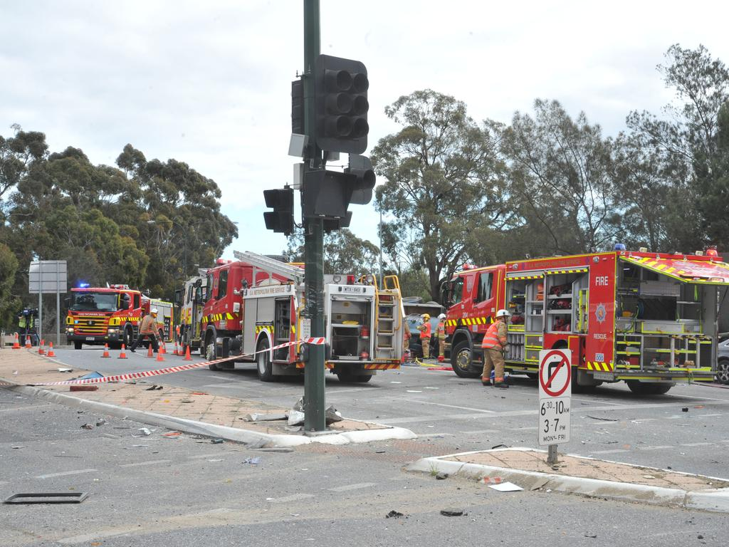 Emergency service workers at the crash on the corner of Glen Osmond and Cross roads. Picture: Roger Wyman