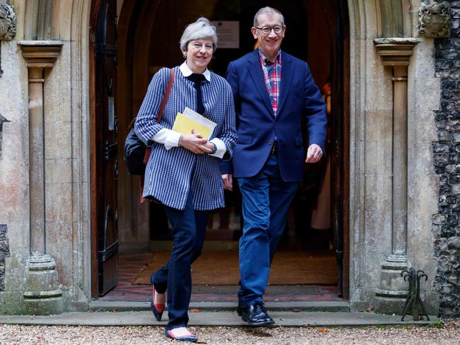 British Prime Minister Theresa May and her husband Philip May. Mrs May said she needed a stiff drink more than a hug after her troubled conference speech. Picture: AFP Photo/Tolga Akmen