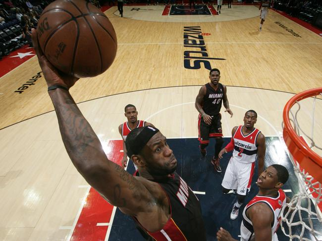 LeBron James formerly of the Miami Heat dunks against the Washington Wizards