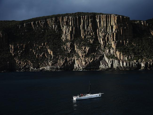 The crew aboard Wedgetail seek shelter north of Tasman Island after breaking their mast during day 4 of the 2013 Rolex Sydney Hobart Yacht Race. Picture: Brett Costello