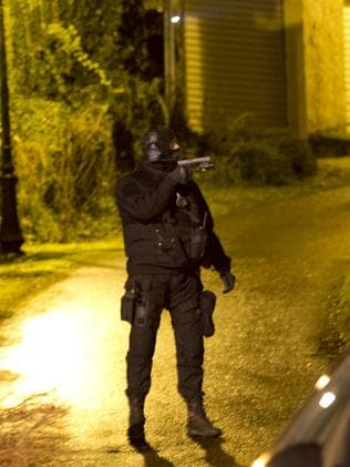 An armed officer guards a road in Fleury, 80 kilometers northeast of Paris. Picture: AP/Peter Dejong.