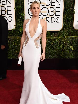 The actress wore a plunging all white Versace dress.