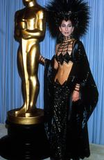 There's a fine line between incredible and terrible ... and singer-turned-actress Cher proves she's incredible every time. Here she is pictured at the 1986 Oscars. Picture: Supplied / File