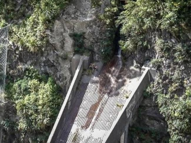 The injured hiker used rope to stop himself from falling onto the rocks below the aqueduct. Picture: NZCC Rescue Helicopter