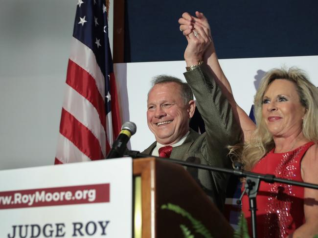 Republican candidate for the US Senate in Alabama, Roy Moore and his wife Kayla greet supporters at an election rally. Picture: AFP