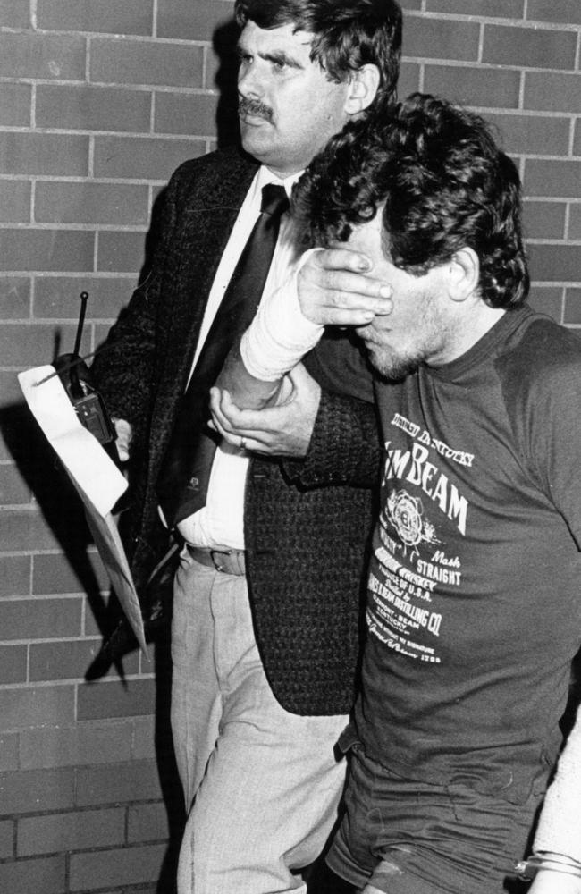 A detective escorts Towner following his arrest for the murder of Lauren Hickson in far Western Sydney.