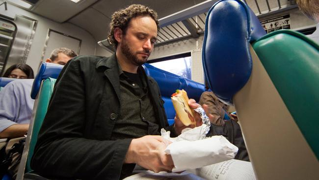 Matthew Vogel Matthew, relaxes with a sandwich and a beer during the evening commute to Pleasantville, NY. Age: 30. Time: 6:59 PM. Location: White Plains, Harlem Line. Photo: Miho Aikawa.