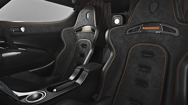 The Koenigsegg One:1 interior, including that all important cup holder.