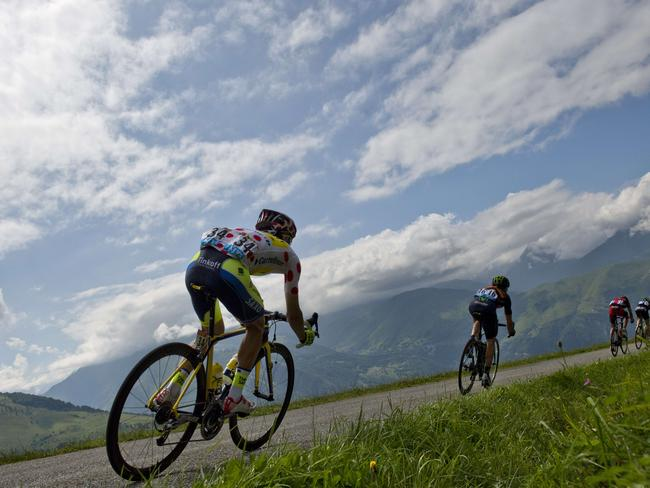 Poland's Rafal Majka (left) wearing the best climber's polka dot jersey rides in a breakaway during the 124.5km seventeenth stage of the Tour de France. Picture: Jeff Pachoud