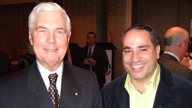 An image of Dimitris de Angelis with former governor general Michael Jeffery