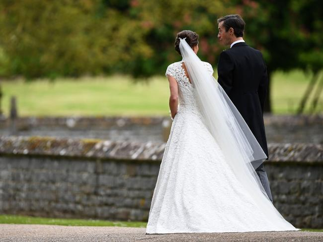 Pippa and her new husband James leave St Mark's Church.