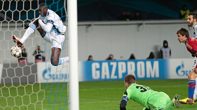 Manchester City's Yaya Toure, left, misses a chance to score as Moscow goalkeeper Igor Akinfeev dives during the UEFA Champions League group D soccer match between CSKA Moscow and Manchester City