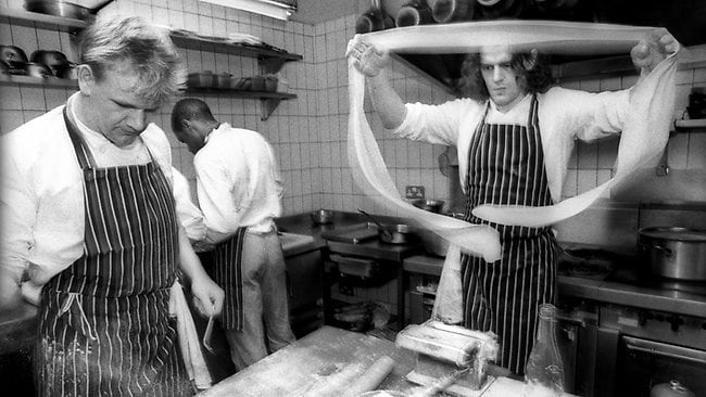 Marco Pierre White (right) with assistant or second chef Gordon Ramsay at Harveys restaurant in Wandsworth Common, London, June 1989. White gave Ramsay his chance in the business before Ramsay left and the two had a falling out. Picture: Christopher Pillitz/Getty Images