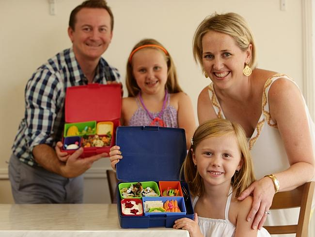 Packing lunches ... Carla and Scott Burns with their daughters Imogen, 7, and Lottie, 6, with their amazing Bento lunch boxes...