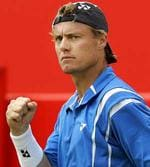 <p>Australia's Lleyton Hewitt reacts during his tennis match against Britain's Joshua Goodall on the first day of The Artois Championships at The Queen's Club in London.</p>