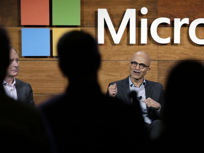 Microsoft CEO Satya Nadella takes a question from the audience at the annual Microsoft shareholders meeting as Brad Smith, left. Picture: AP