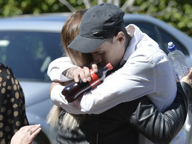 Emotional friends of murdered woman Sharon Michelutti embrace after Gavin de Beyer's sentencing. Picture: Jeremy Piper.