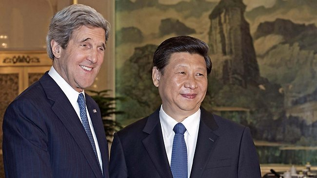 U.S. Secretary of State John Kerry, left, is greeted by Chinese President Xi Jinping shortly before their meetings at the Great Hall of the People Saturday, April 13, 2013 in Beijing. The question of how Washington can persuade Beijing to exert real pressure on North Korean leader Kim Jong Un's unpredictable regime is front and center as Kerry meets Saturday with Chinese leaders in Beijing. (AP Photo/Paul J. Richards, Pool)