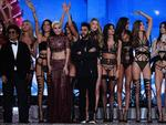 Bruno Mars, Lady Gaga and TThe Weeknd cheer alongside Victoria's Secret Angelsrduring the 2016 Victoria's Secret Fashion Show at the Grand Palais in Paris. Picture: AFP