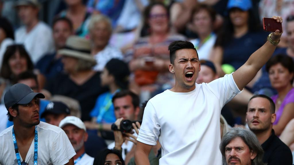 A spectator interrupts the second round match between Nick Kyrgios and  Viktor Troicki. Pic: