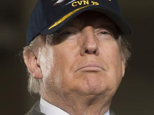 (FILES) This file photo taken on March 2, 2017 shows US President Donald Trump aboard the pre-commissioned USS Gerald R. Ford aircraft carrier in Newport News, Virginia, March 2, 2017. US President Donald Trump is to sign a revised executive order on immigration March 6, 2017, after his first version was blocked by federal courts, senior aide Kellyanne Conway said. Conway told Fox News that the order would take effect on March 16. The first version temporarily closed US borders to all refugees and citizens from seven mainly Muslim countries. / AFP PHOTO / SAUL LOEB