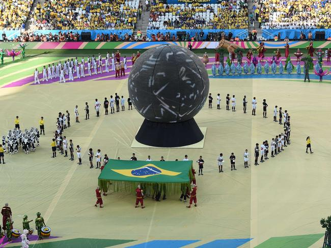 Performers take part in the opening ceremony of the 2014 FIFA World Cup in Sao Paulo, prior to the opening match.