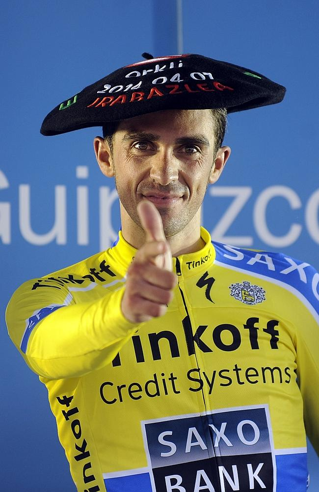 Team Tinkoff's Alberto Contador celebrates on the podium after winning the first stage of the Tour of the Basque Country, a 153.4km ride around Ordizia, northern Spain, on April 7, 2014. AFP PHOTO / RAFA RIVAS