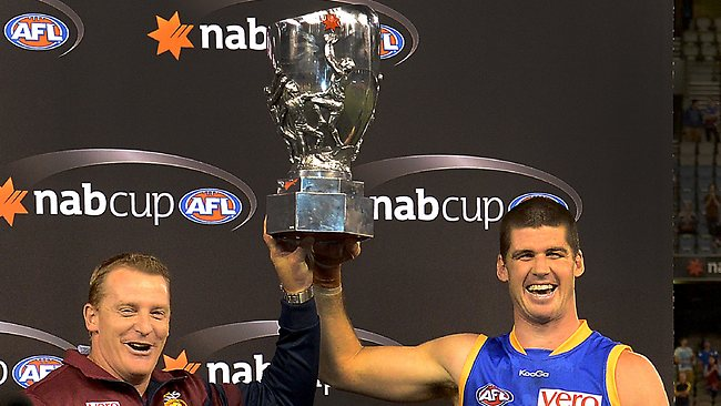 Michael Voss and Jonathan Brown celebrate winning this year's NAB Cup. Picture: Wayne Ludbey