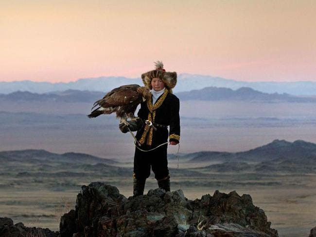 Aisholpan Nurgaiv stands against the spectacular backdrop of the Altai Mountains in Mongolia. Picture: Asher Svidensky