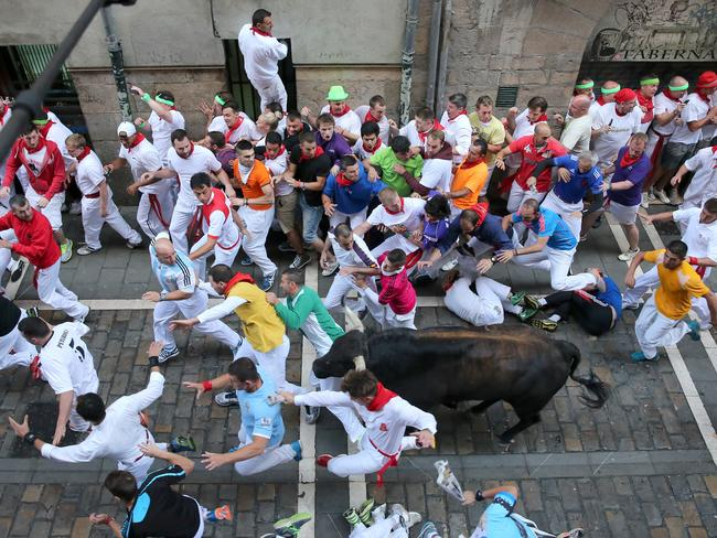Run! ... revellers run with Dolores Aguirre Ybarra's fighting bulls along the Plaza Consistorial.