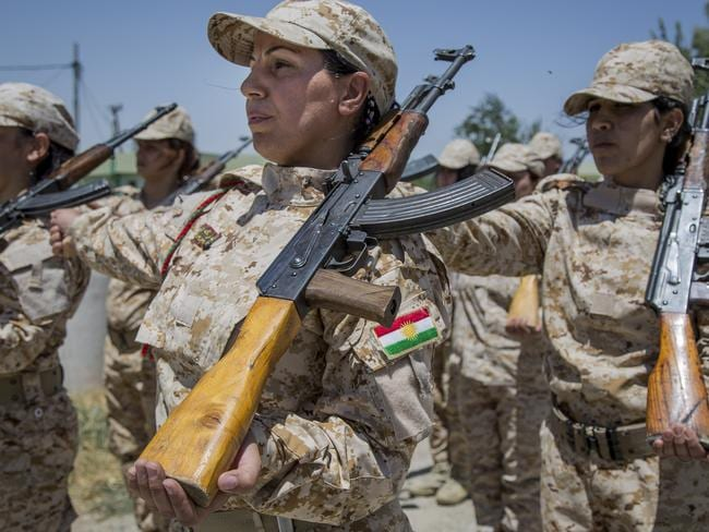 Women Peshmergas of the 2nd Battalion stand to attention.