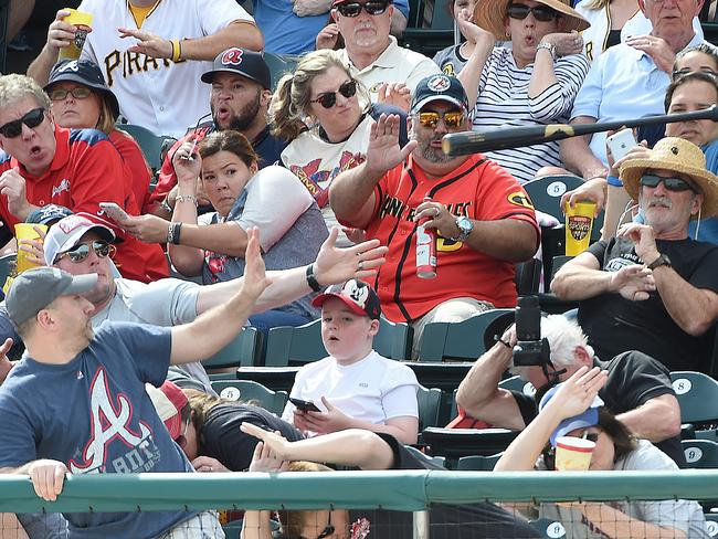 Ortiz's bat goes flying into the crowd. Picture: Christopher Horner/Tribune-Review