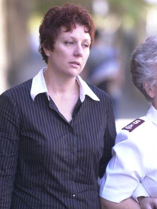 Kathleen Folbigg leaves court during her 2003 trial. Photo: News Corp