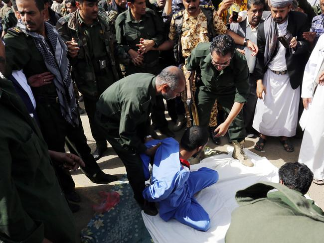 "Mohammed al-Moghrabi, pictured sitting down, was sentenced to execution after 100 lashes &   quot;in a public place"" by a court run by the country's Huthi rebels, who control the capital Sanaa. Picture: AFP"